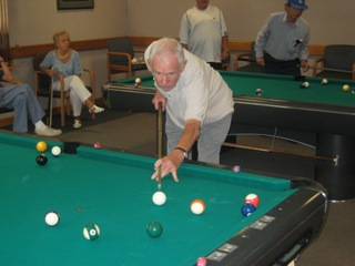 People playing billiards