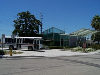 Front View of Downey Depot and DowneyLINK Bus leaving the depot