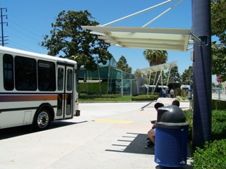View of DowneyLINK Bus and Depot Bus Stop with the Downey Depot in the background